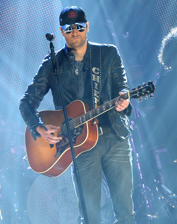 Description of . Eric Church performs onstage during the 2012 CMT Artists Of The Year at The Factory at Franklin on December 3, 2012 in Franklin, Tennessee.  (Photo by Rick Diamond/Getty Images for CMT)
