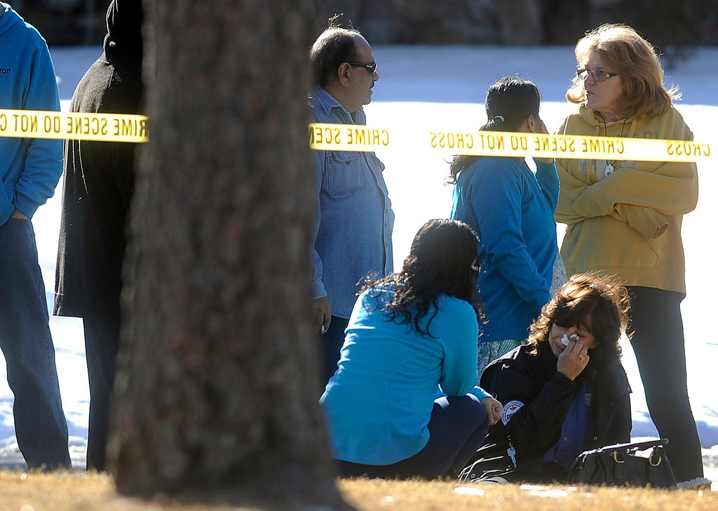 Description of . Friends and neighbors react outside a townhouse complex following an overnight hostage-taking incident in Aurora, Colorado January 5, 2013.  Four people died including the gunman according to police reports after several hours of failed police negotiations when the gunman barricaded himself at the home with hostages in the same town where a man shot dead 12 people and wounded 58 more at a movie theatre last July.     REUTERS/Evan Semon