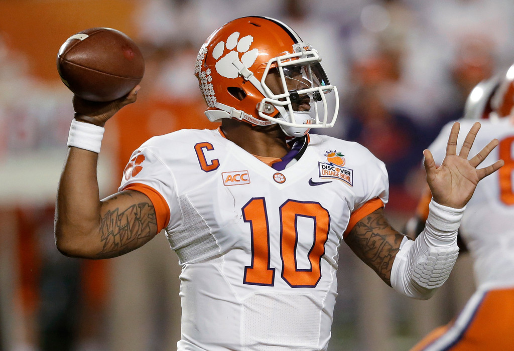 Description of . Clemson quarterback Tajh Boyd stands back to pass during the first half of the Orange Bowl NCAA college football game against Ohio State, Friday, Jan. 3, 2014, in Miami Gardens, Fla. (AP Photo/Wilfredo Lee)