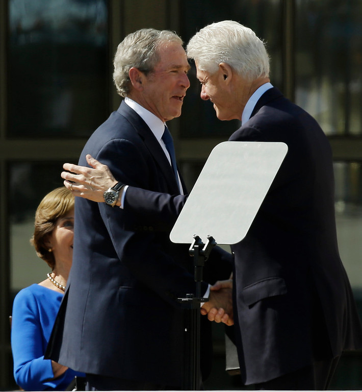 Description of . Former president George W. Bush, left, shakes hands with former president William J. Clinton during the dedication of the George W. Bush Presidential Center Thursday, April 25, 2013, in Dallas. (AP Photo/David J. Phillip)