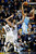 Denver Nuggets center JaVale McGee (34) goes to the basket against Memphis Grizzlies Marc Gasol, center, of Spain, and Rudy Gay (22) in the second half of an NBA basketball game on Saturday, Dec. 29, 2012, in Memphis, Tenn. The Grizzlies won 81-72. (AP Photo/Lance Murphey)