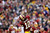 Washington Redskins quarterback Robert Griffin III reacts to his touchdown pass to wide receiver Josh Morgan during the first half of an NFL football game against the Baltimore Ravens in Landover, Md., Sunday, Dec. 9, 2012. (AP Photo/Patrick Semansky)