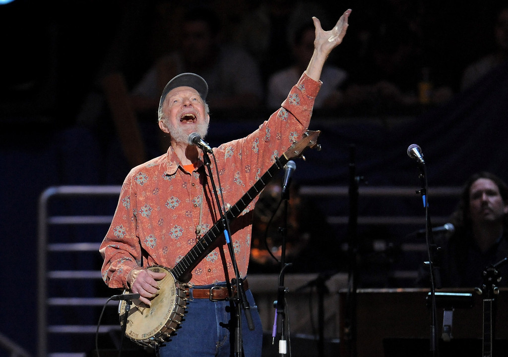 Description of . Pete Seeger performs at the benefit concert celebrating his 90th birthday at Madison Square Garden on Sunday, May 3, 2009 in New York. The concert is a benefit for Hudson River Sloop Clearwater, created by Pete Seeger to preserve and protect the Hudson River. (AP Photo/Evan Agostini)