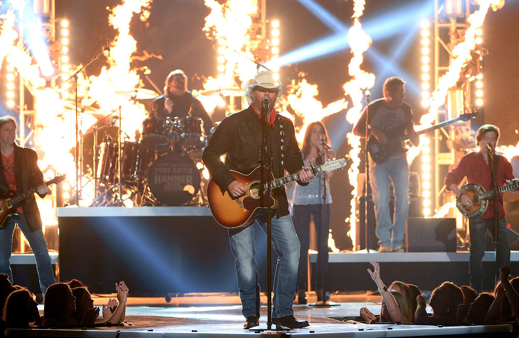 Description of . Singer Toby Keith performs onstage during the 49th Annual Academy Of Country Music Awards at the MGM Grand Garden Arena on April 6, 2014 in Las Vegas, Nevada.  (Photo by Ethan Miller/Getty Images)