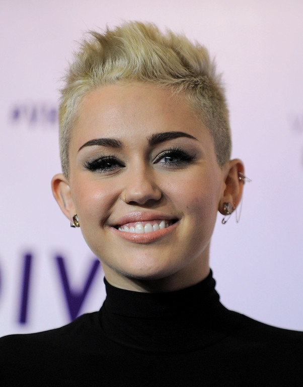 Description of . Miley Cyrus arrives at VH1 Divas on Sunday, Dec. 16, 2012, at the Shrine Auditorium in Los Angeles. (Photo by Jordan Strauss/Invision/AP)