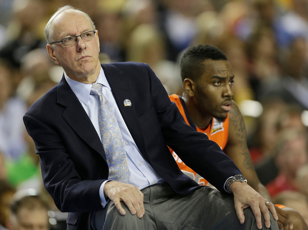 Description of . Syracuse head coach Jim Boeheim watches play against Michigan during the first half of the NCAA Final Four tournament college basketball semifinal game Saturday, April 6, 2013, in Atlanta. (AP Photo/John Bazemore)
