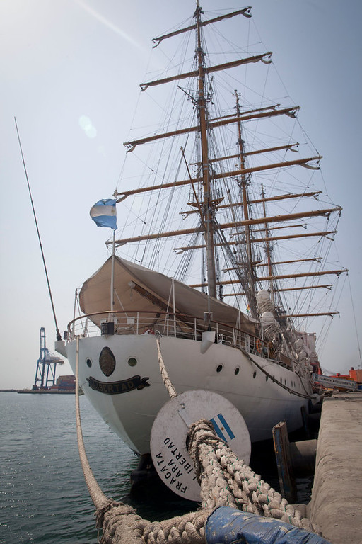 Description of . Argentina\'s three-masted navy training tall ship ARA Libertad, which was seized on Oct. 2 as collateral for unpaid bonds dating from Argentina\'s economic crisis a decade ago, sits docked at the port in Tema, outside Accra, in Ghana Friday, Dec. 14, 2012. A U.N. court is expected on Saturday to deliver its order on whether the Argentine navy ship being held at the Ghanaian port should be released. (AP Photo/Gabriela Barnuevo)