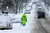 A crossing guard walks down a snow-covered street in Somerville, Massachusetts March 8, 2013.     REUTERS/Brian Snyder
