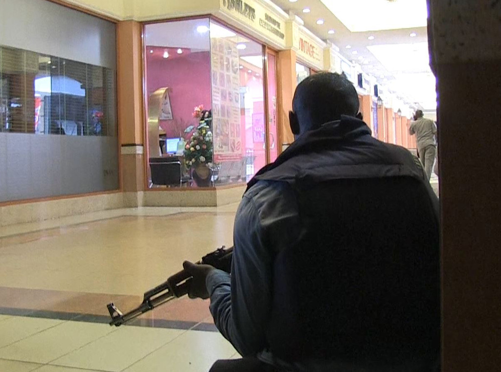 Description of . An image grab taken from AFP TV shows a member of the Kenyan security forces taking position inside a shopping mall following an attack by masked gunmen in Nairobi on September 21, 2013. AFP PHOTO/AFPTV/NICHOLE Sobecki/AFP/Getty Images
