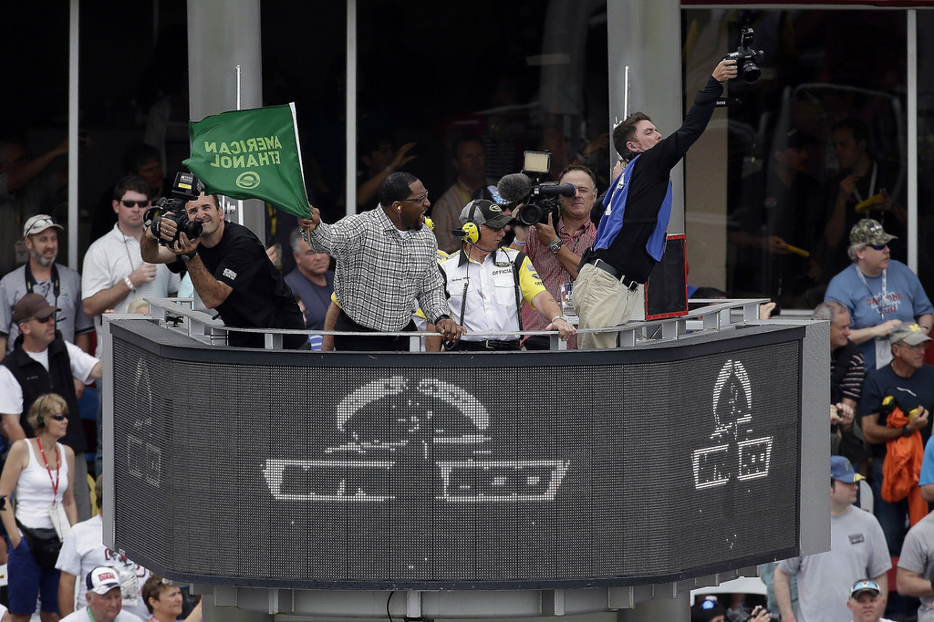 . Former Baltimore Ravens linebacker Ray Lewis waves the green to start of the Daytona 500 NASCAR Sprint Cup Series auto race Sunday, Feb. 24, 2013, at Daytona International Speedway in Daytona Beach, Fla.  (AP Photo/Chris O\'Meara)