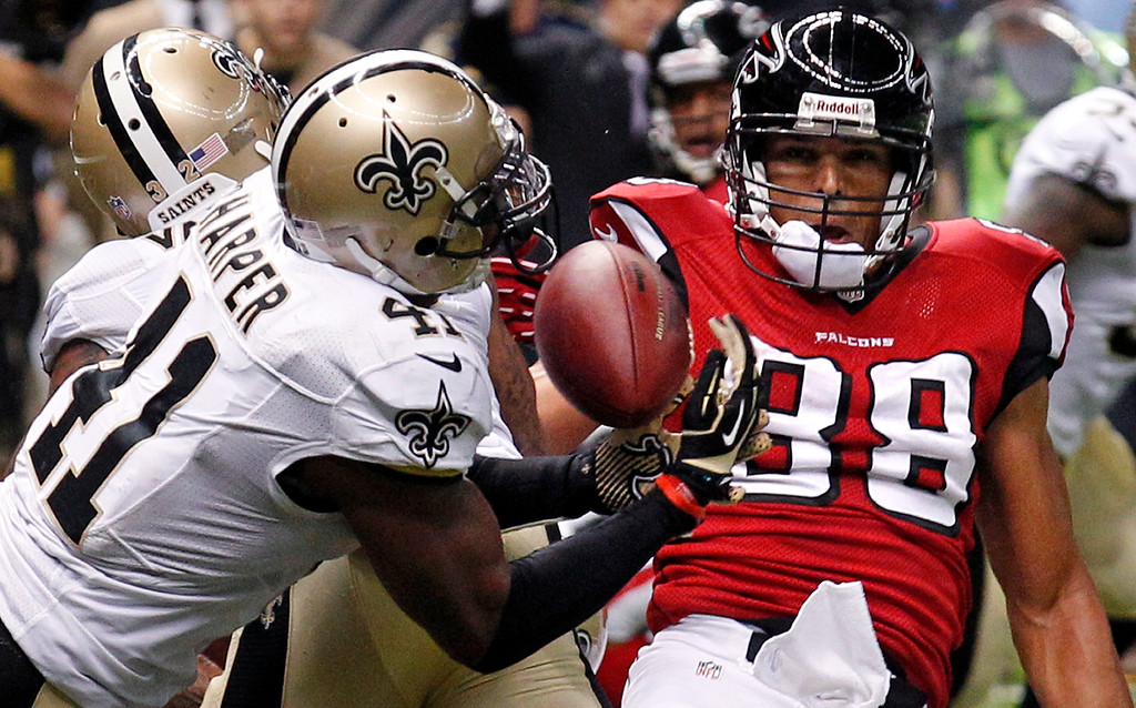 Description of . New Orleans Saints strong safety Roman Harper (41) intercepts a pass in the end zone in the final moments of an NFL football game to seal a win against the Atlanta Falcons in New Orleans, Sunday, Sept. 8, 2013. The Saints won 23-17. (AP Photo/Bill Haber)