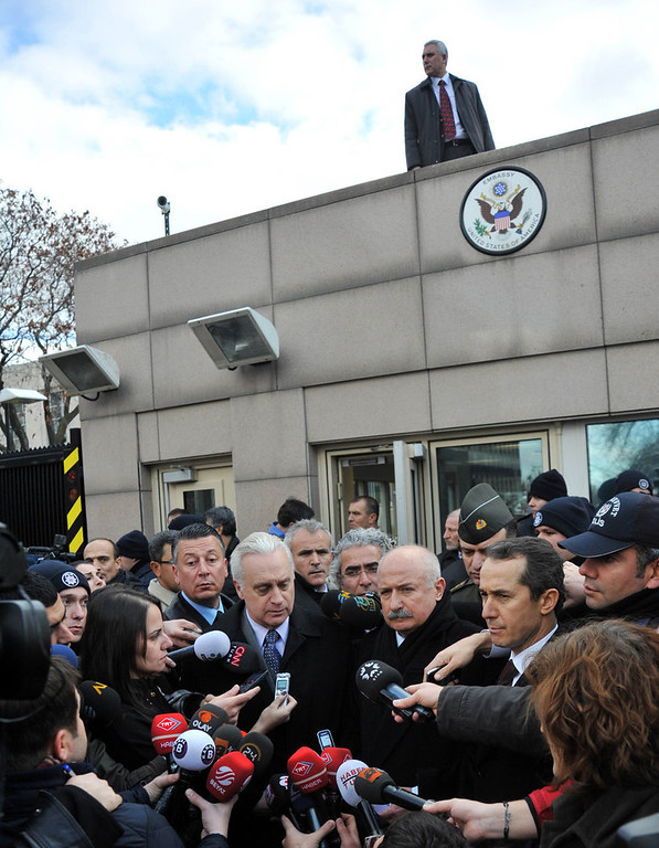 Description of . US ambassador to Turkey Francis J. Ricciardone (C, L) and provincial governor Alaaddin Yuksel (C, R) give a press point on February 1, 2013 at the site of a blast outside the US Embassy in Ankara. A Turkish security guard was killed and several other people wounded in a suicide bombing at the entrance to the highly-fortified US embassy in Ankara on February 1, officials said. The force of the blast damaged nearby buildings in the upmarket Cankaya neighborhood of the capital where many other state institutions and embassies are also located.    AFP PHOTO / ADEM  ALTAN/AFP/Getty Images