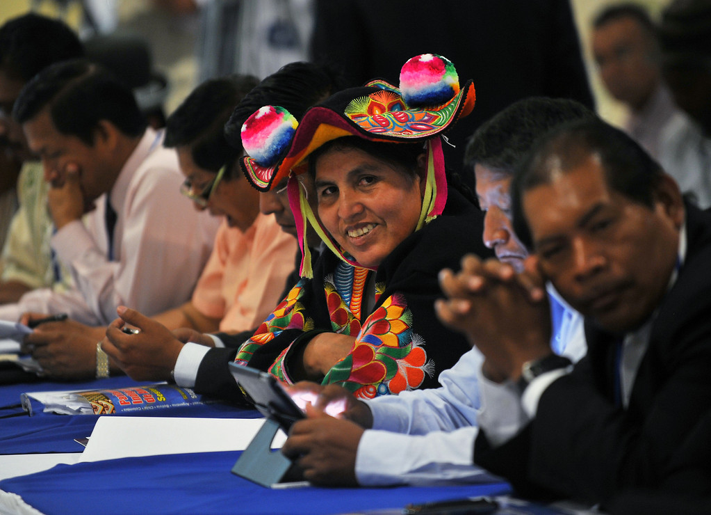 . Peruvian native Claudia Coari (C), of the department of Puno, participates in the XIII Session of the Indigenous Parliament of America (PIA in Spanish) --which deals with food security issues-- in Managua, on April 8, 2013. HECTOR RETAMAL/AFP/Getty Images