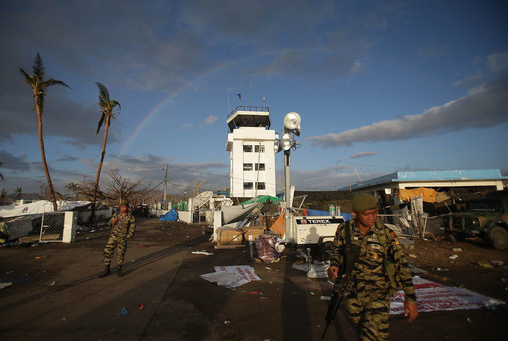 Description of . A rainbow is seen from the airport of typhoon-hit Tacloban, Leyte province, central Philippines Monday, Nov. 18, 2013. Corruption is a concern after any major natural disaster, as millions of dollars in cash and goods rush in from around the world. But those worries are especially acute in the Philippines, where graft has been a part of life for decades. (AP Photo/Aaron Favila)