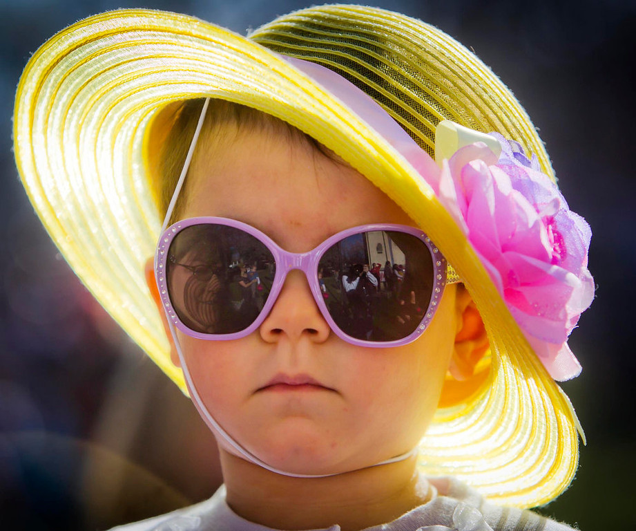 Description of . Adellese El-Mansouri, 1 1/2, Boise, keeps her game face while looking radiant in her Easter bonnet just prior to the Mix 106 Easter Egg Scramble Saturday March 30, 2013 at Julia Davis Park in Boise, Idaho.  (AP Photo/Idaho Statesman, Darin Oswald)