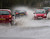 Motorists tackle a flash flood near Tewkesbury at the confluence of the River Severn and the River Avon on December 24, 2012 in England. Forecasters have predicted more rain to sweep across the country causing flash flooding over the coming days.  The South West of England has been badly affected causing major disruption to the rail network delaying journeys for people making their way home for Christmas.  (Photo by Christopher Furlong/Getty Images)
