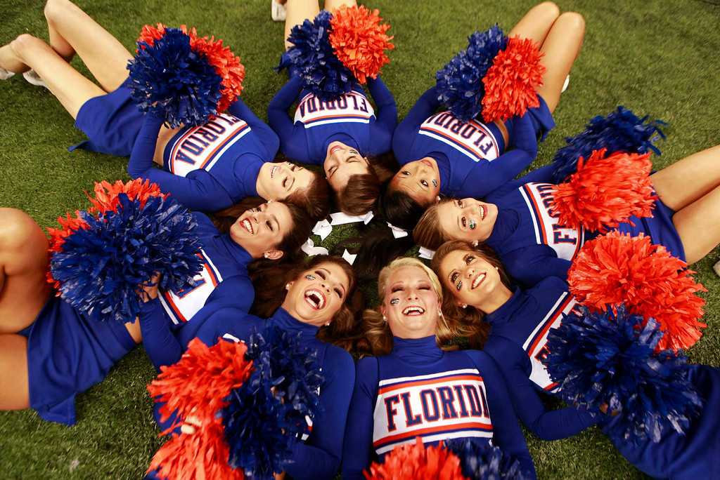 Description of . Florida Gators cheerleaders pose before their team play the Louisville Cardinals in their 2013 Allstate Sugar Bowl NCAA football game in New Orleans, Louisiana January 2, 2013.  REUTERS/Sean Gardner