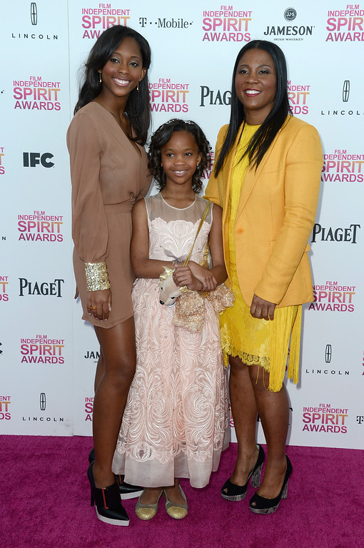Description of . SANTA MONICA, CA - FEBRUARY 23:  Actress Quvenzhane Wallis (front), mother Qulyndreia Wallis (L) and sister Qunyquekya Wallis attend the 2013 Film Independent Spirit Awards at Santa Monica Beach on February 23, 2013 in Santa Monica, California.  (Photo by Frazer Harrison/Getty Images)