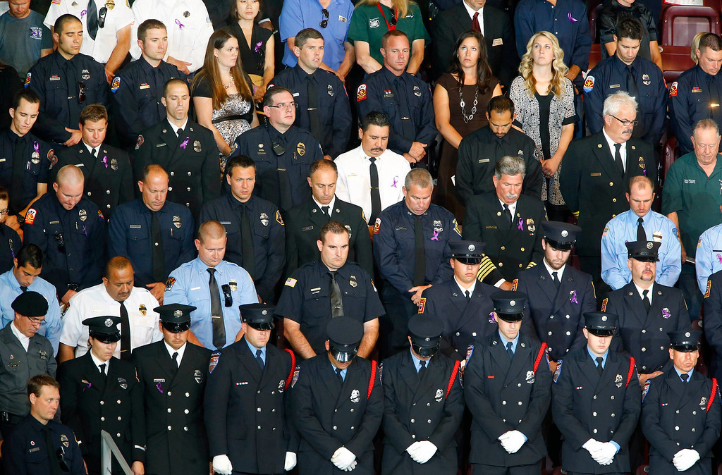 Description of . Dignitaries, officials, family members and firefighters from across the country attend the memorial service for 19 Granite Mountain hotshot firefighters at Tim's Toyota Center in Prescott Valley, Arizona July 9, 2013.   REUTERS/David Kadlubowski/Pool