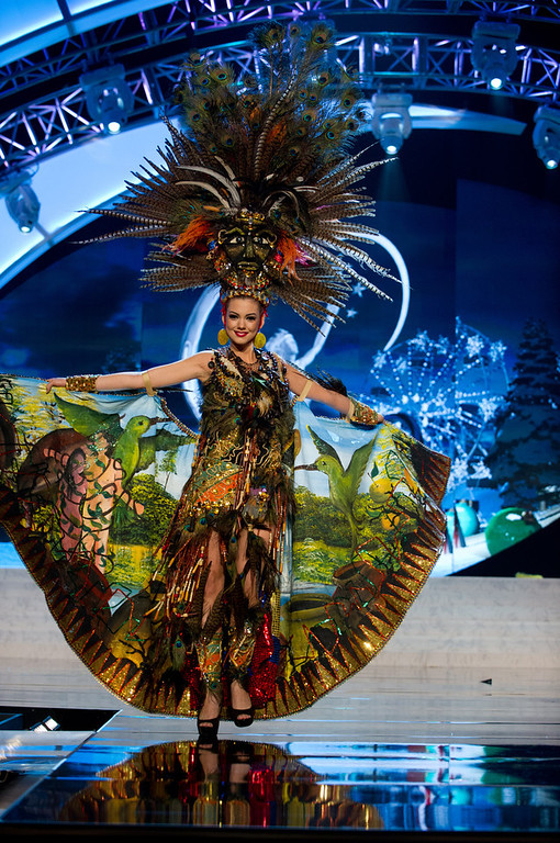 Description of . Miss Ecuador 2012, Carolina Andrea Aguirre P�rez, performs onstage at the 2012 Miss Universe National Costume Show on Friday, Dec. 14, 2012 at PH Live in Las Vegas, Nevada. The 89 Miss Universe Contestants will compete for the Diamond Nexus Crown on Dec. 19, 2012. (AP Photo/Miss Universe Organization L.P., LLLP)