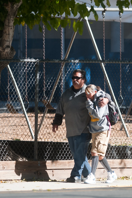 Description of . A parent escorts his child from Agnes Risley Elementary school following a shooting at nearby Sparks Middle School October 21, 2013 in Sparks, Nevada.   (Photo by David Calvert/Getty Images)