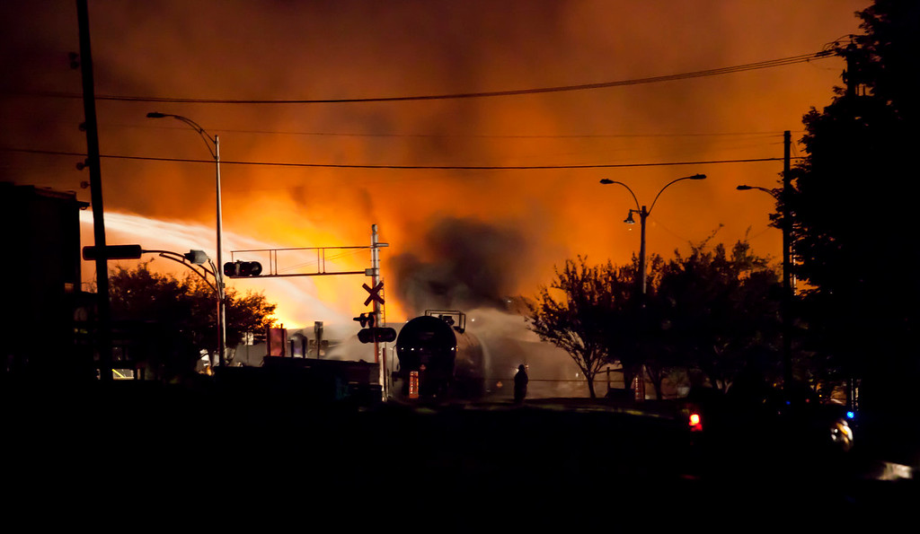 Description of . Firefighters douse blazes after a freight train loaded with oil derailed in Lac-Megantic in Canada\'s Quebec province on July 6, 2013, sparking explosions that engulfed about 30 buildings in fire.  At least 40 people are missing after a driverless oil tanker train derailed and exploded in the small Canadian town of Lac-Megantic, destroying dozens of buildings, a firefighter back from the scene told AFP.    Fran�ois Laplante-Delagrave/AFP/Getty Images