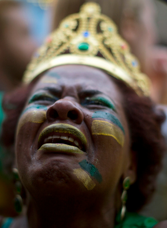 Description of . A Brazil soccer fan weeps as she watches Germany score repeatedly against Brazil at a World Cup semifinal match on a live telecast inside the FIFA Fan Fest area in Sao Paulo, Brazil, Tuesday, July 8, 2014. (AP Photo/Dario Lopez-Mills)