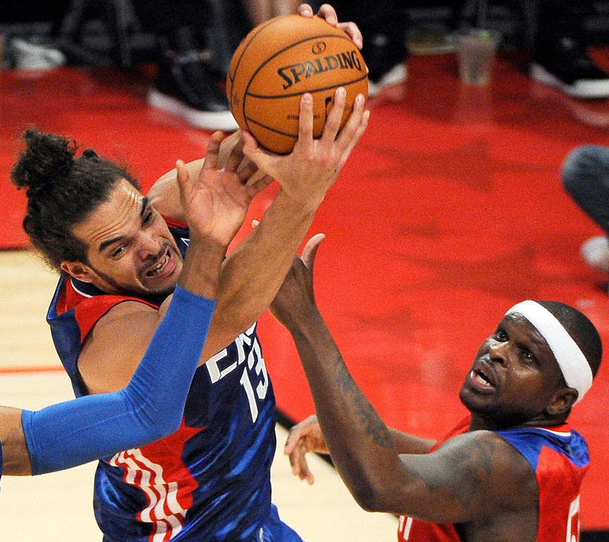 Description of . East Team's Joakim Noah from France, of the Chicago Bulls and West Team's Zach Randolph of the Memphis Grizzlies battle for a rebound during the first half of the NBA All-Star basketball game Sunday, Feb. 17, 2013, in Houston. (AP Photo/Pat Sullivan)