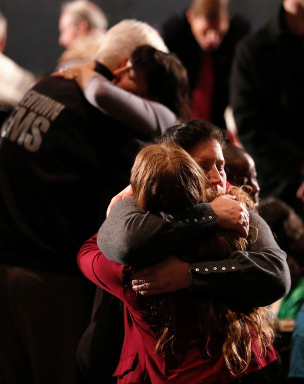 Description of . Women embrace at a vigil held at Newtown High School for families of the Sandy Hook Elementary School shooting victims in Newtown, Connecticut December 16, 2012. U.S. President Barack Obama is visiting Newtown High School to meet with the families of the victims and to thank first responders to the school shooting here, which was one of the deadliest such incidents in the nation's history. REUTERS/Kevin Lamarque