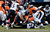 Denver Broncos running back Jacob Hester (40) gets stopped after taking a hand off from Denver Broncos quarterback Peyton Manning (18) during the first half.  The Denver Broncos vs Baltimore Ravens AFC Divisional playoff game at Sports Authority Field Saturday January 12, 2013. (Photo by Hyoung Chang,/The Denver Post)