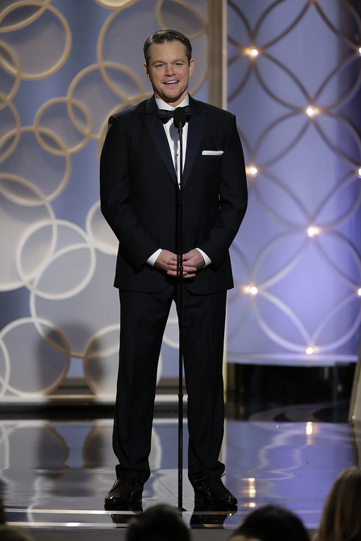 Description of . In this handout photo provided by NBCUniversal, Presenter Matt Damon speaks onstage during the 71st Annual Golden Globe Award at The Beverly Hilton Hotel on January 12, 2014 in Beverly Hills, California.  (Photo by Handout/Getty Images)