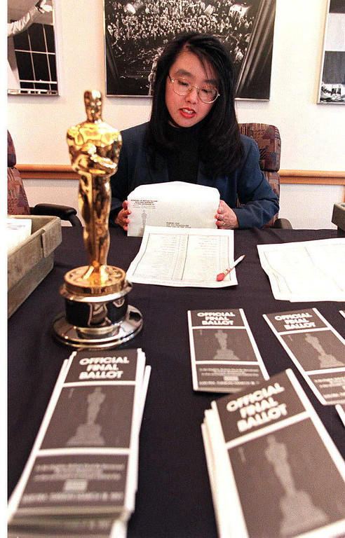 Description of . Claire Chang, a representative of the Academy of Motion Picture Arts and Sciences, prepares the final Oscar ballots for mailing to members of the academy 04 March who will decide this year's winners of the Academy Awards.  The Oscar show will take place 24 March in Los Angeles.  HECTOR MATA/AFP/Getty Images