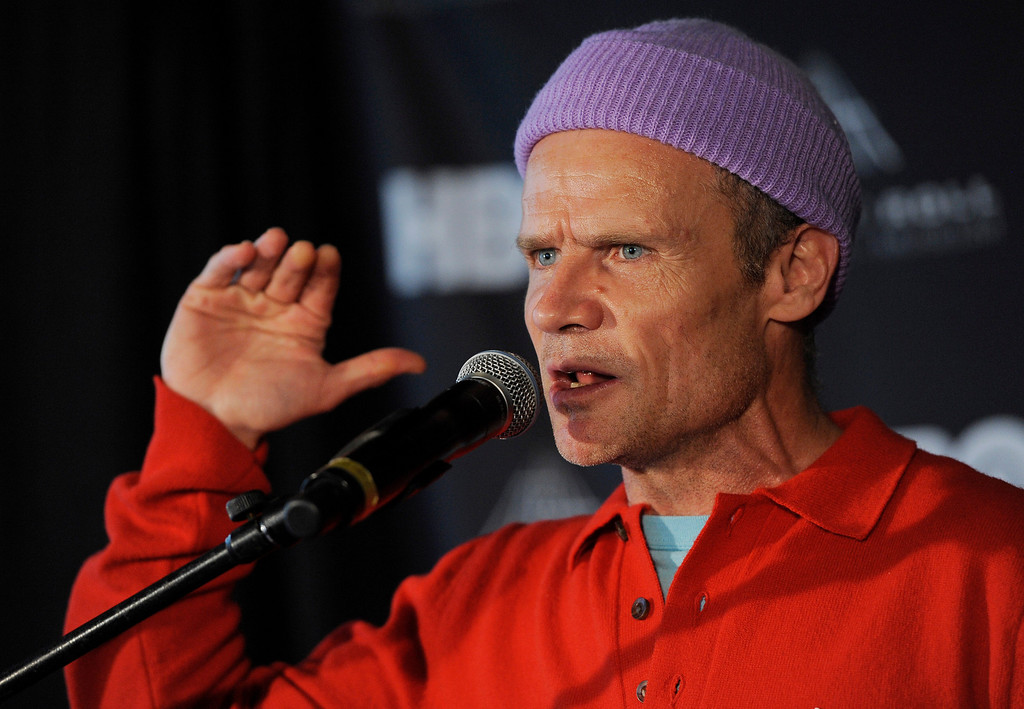 Description of . Rock and Roll Hall of Fame inductee Flea of the Red Hot Chili Peppers speaks at a news conference to announce the 2013 inductees, Tuesday, Dec. 11, 2012, in Los Angeles. The 28th Annual Rock and Roll Hall of Fame Induction Ceremony will be held at the Nokia Theatre L.A. Live in Los Angeles on April 18, 2013. (Photo by Chris Pizzello/Invision/AP)