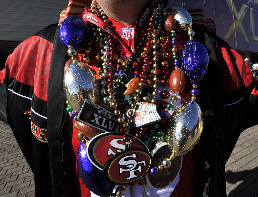 Description of . A San Francisco 49ers fan poses outside the Mercedes-Benz Superdome in New Orleans before the start of Super Bowl XLVII between the San Francisco 49ers and the Baltimore Ravens on February 3, 2013.    TIMOTHY A. CLARY/AFP/Getty Images