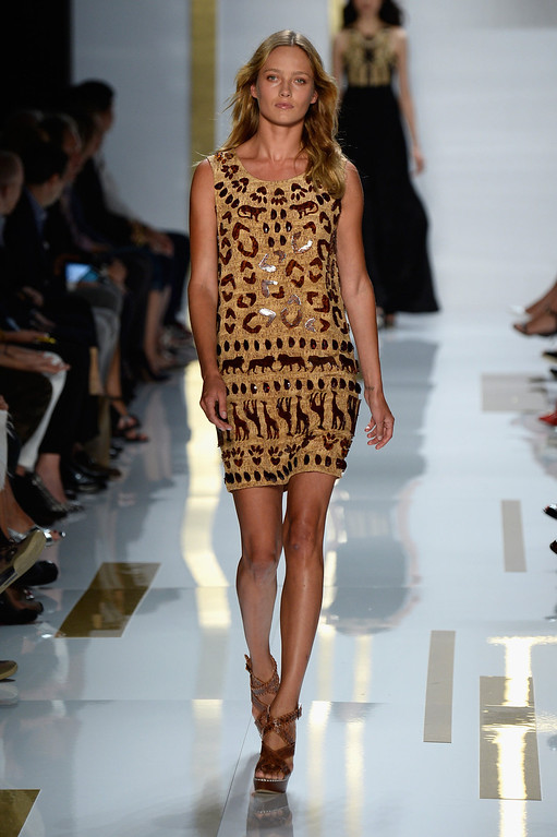 Description of . Model Karmen Pedaru walks the runway at the Diane Von Furstenberg fashion show during Mercedes-Benz Fashion Week Spring 2014 at The Theatre at Lincoln Center on September 8, 2013 in New York City.  (Photo by Frazer Harrison/Getty Images for Mercedes-Benz Fashion Week Spring 2014)