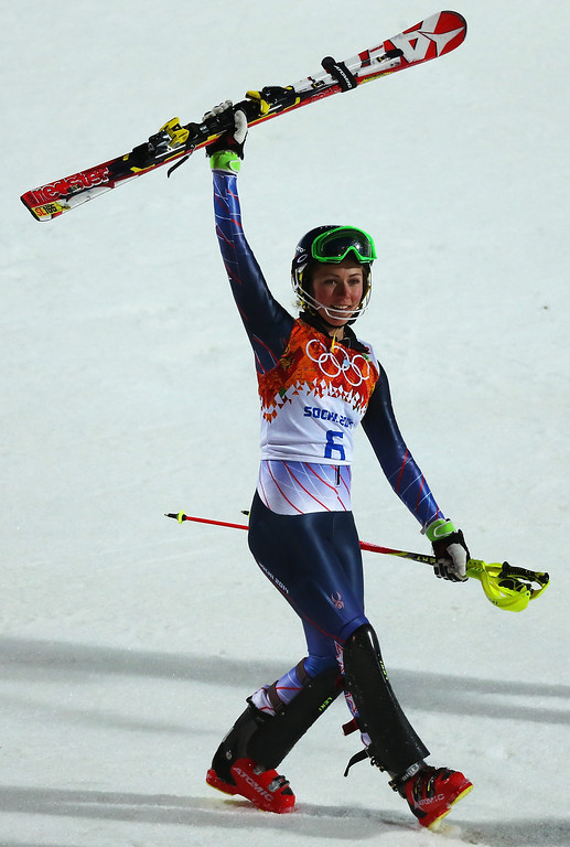 Description of . Mikaela Shiffrin of the United States celebrates winning gold after her second run during the Women's Slalom during day 14 of the Sochi 2014 Winter Olympics at Rosa Khutor Alpine Center on February 21, 2014 in Sochi, Russia.  (Photo by Alexander Hassenstein/Getty Images)