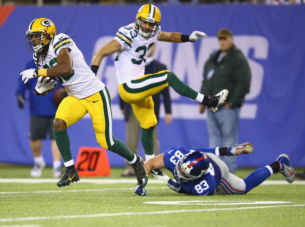 Description of . Tramon Williams #38 of the Green Bay Packers runs after making an interception as  Brandon Myers #83 of the New York Giants misses the tackle during their game at MetLife Stadium on November 17, 2013 in East Rutherford, New Jersey.  (Photo by Al Bello/Getty Images)