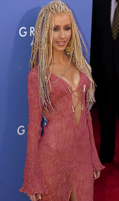 Description of . Christina Aguilera poses as she arrives at the 43rd annual Grammy Awards Wednesday, Feb. 21, 2001, at the Staples Center in Los Angeles. Aguilera is nominated for best latin pop album and best female pop vocal performance.  (AP Photo/Micahel Caulfield)