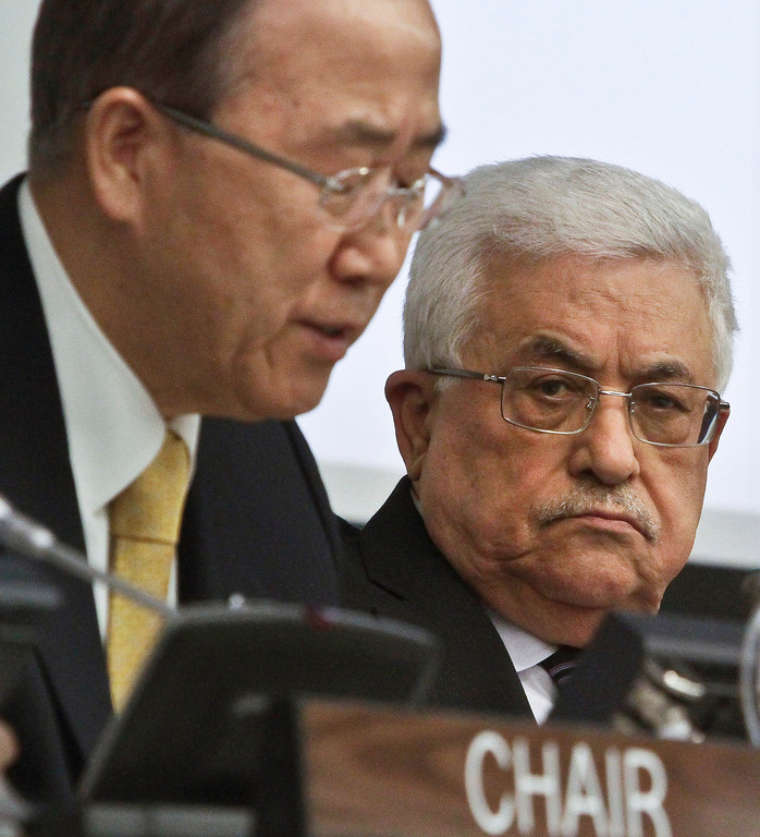 Description of . Palestinian President Mahmoud Abbas, right, listens as U.N. Secretary-General Ban Ki-moon speaks during a meeting on Palestine, Thursday, Nov. 29, 2012. Palestinians are expected to win U.N. recognition as a state, even as the U.S., Israel's closest ally, mounts an aggressive campaign to head off the General Assembly vote.  (AP Photo/Bebeto Matthews)