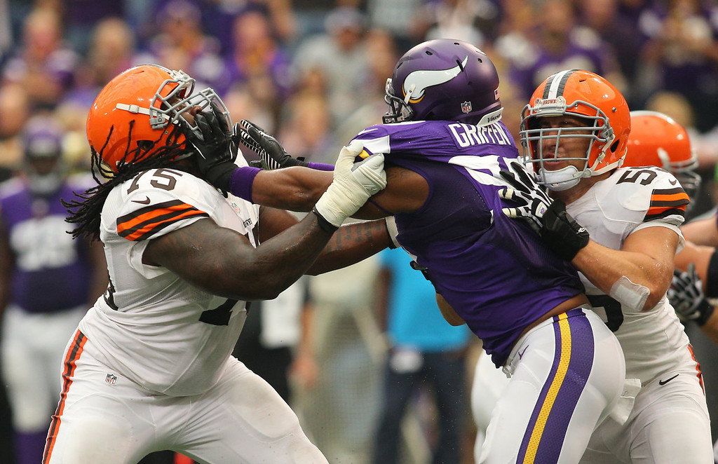 Description of . Everson Griffen #97 of the Minnesota Vikings puts the block on Oniel Cousins #75 of the Cleveland Browns on September 22, 2013 at Mall of America Field at the Hubert Humphrey Metrodome in Minneapolis, Minnesota. (Photo by Adam Bettcher/Getty Images)