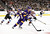 LOS ANGELES, CA - FEBRUARY 23:  Jeff Carter #77 of the Los Angeles Kings clears his zone as P.A. Parenteau #15 and Matt Duchene #9 of the Colorado Avalanche chase at Staples Center on February 23, 2013 in Los Angeles, California.  (Photo by Harry How/Getty Images)