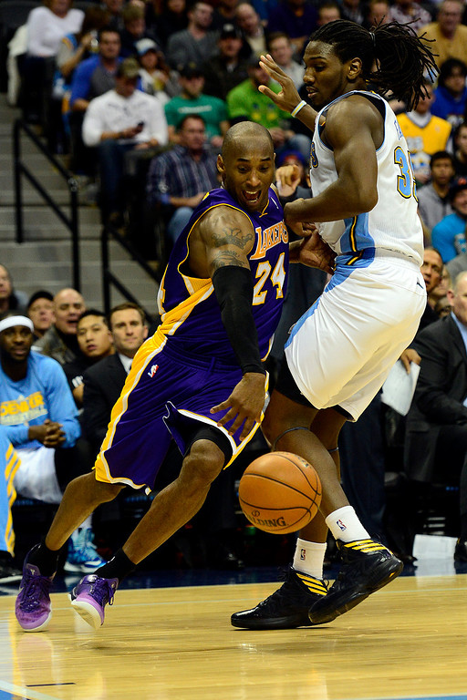 Description of . Los Angeles Lakers shooting guard Kobe Bryant (24) drives around Denver Nuggets small forward Kenneth Faried (35) during the second half of the Nuggets' 126-114 win at the Pepsi Center on Wednesday, December 26, 2012. AAron Ontiveroz, The Denver Post