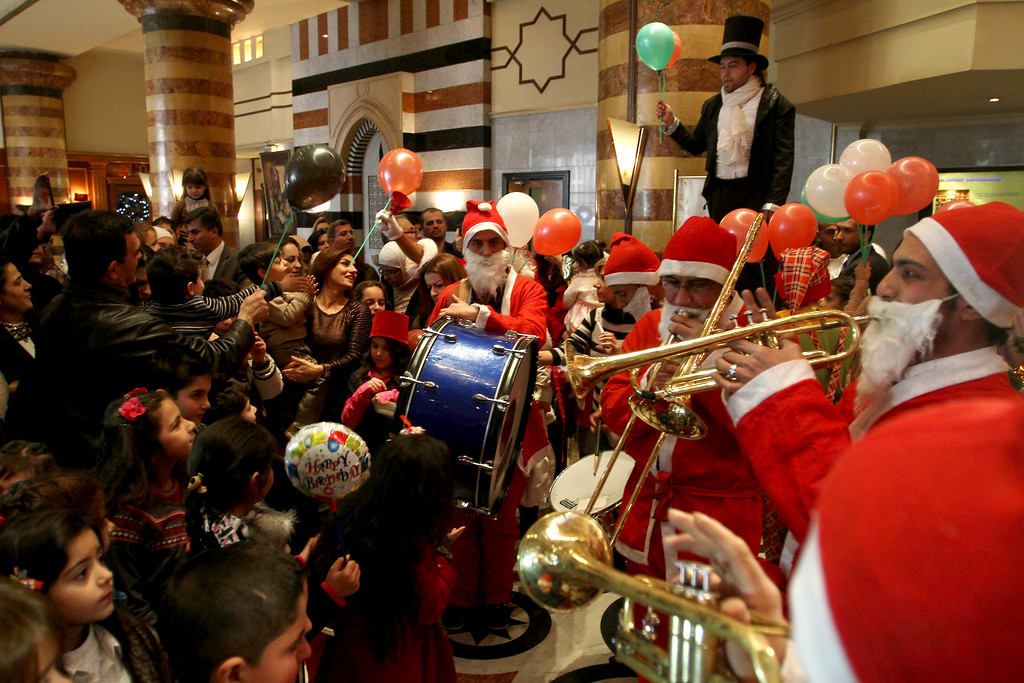Description of . Christians celebrate Christmas during a party held at the Dama Rose hotel in Damascus, Syria on Wednesday, Dec. 25, 2013. Pope Francis' Christmas message, delivered on Wednesday in Italian from the central balcony of St. Peter's Basilica, addressed the Syrian conflict: