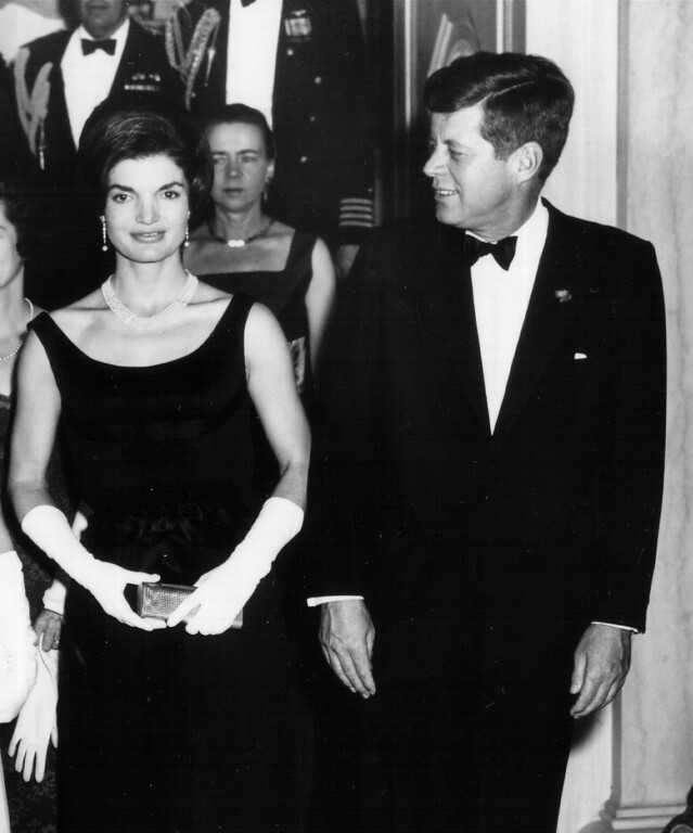 Description of . President Kennedy and Jacqueline attend a White House ceremony Feb. 19, 1963, in Washington.  National Archive/Newsmakers