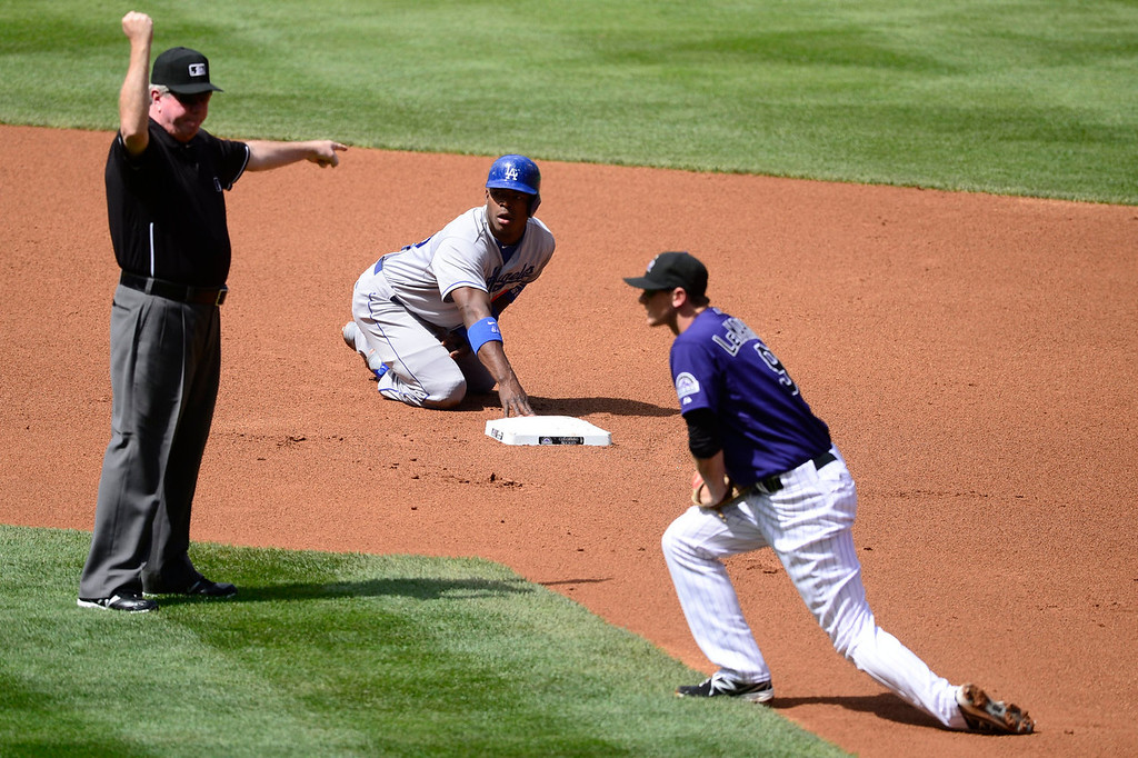Description of . Yasiel Puig (66) of the Los Angeles Dodgers is called out after colliding with DJ LeMahieu (9) of the Colorado Rockies during the action in Denver on Monday, September 2, 2013. The Colorado Rockies hosted the Los Angeles Dodgers at Coors Field.   (Photo by AAron Ontiveroz/The Denver Post)