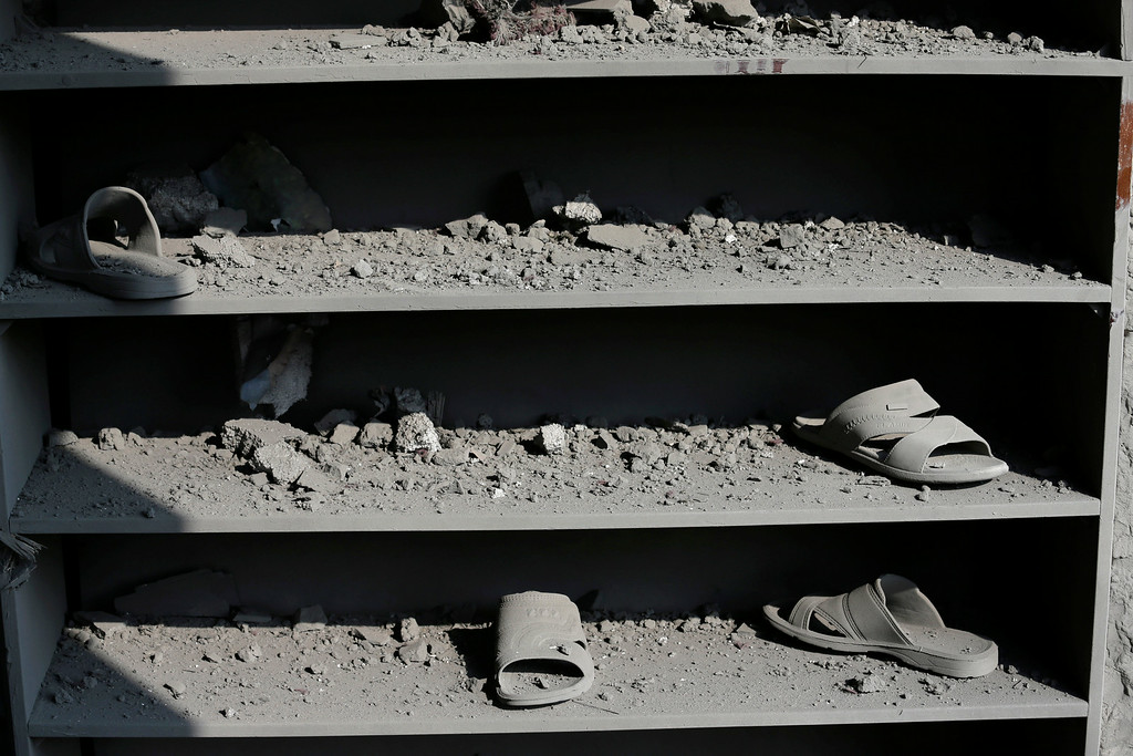 Description of . Shelves for the shoes of Muslim worshippers are seen damaged at the Ameen mosque in Gaza City, northern Gaza Strip, destroyed by an Israeli strike, Tuesday, July 29, 2014. (AP Photo/Lefteris Pitarakis)
