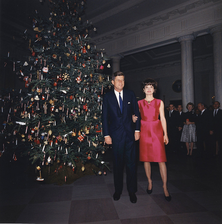 Description of . The president and first lady attend a White House staff Christmas Party on Dec. 7, 1962 in Washington. John F. Kennedy Presidential Library and Museum
