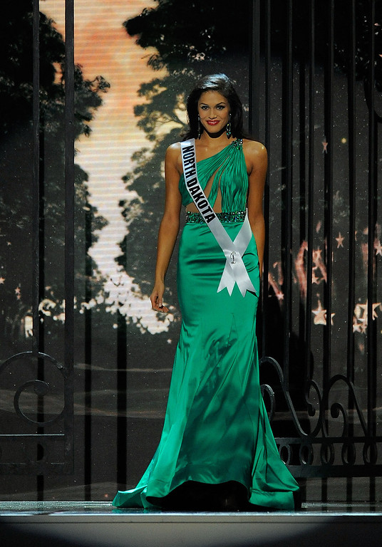 Description of . Miss North Dakota USA Audra Mari competes in the 2014 Miss USA Competition at The Baton Rouge River Center on June 8, 2014 in Baton Rouge, Louisiana.  (Photo by Stacy Revere/Getty Images)