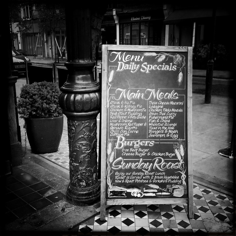 Description of . A menu is displayed outside a pub on May 2, 2012 in London, England. (Photo by Vittorio Zunino Celotto/Getty Images)