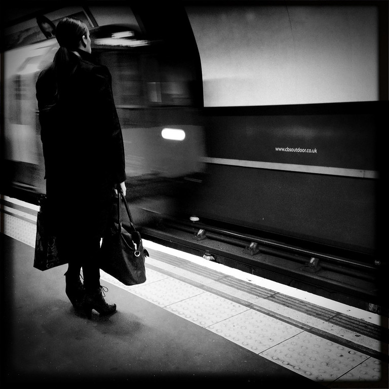 Description of . A woman is waiting for the tube on May 2, 2012 in London, England. (Photo by Vittorio Zunino Celotto/Getty Images)